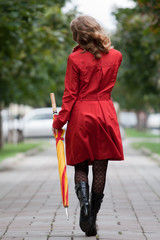 woman walking with an umbrella