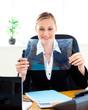 Confident businesswoman preparing slides for a presentation in h