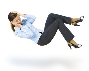 woman in a business suit falls down