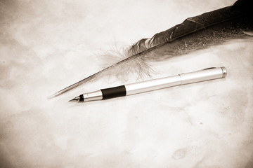 image of feather and pen
