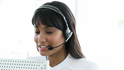 Pretty business woman working in a call centre