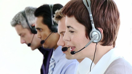 close-up of a woman working in a call-center with men