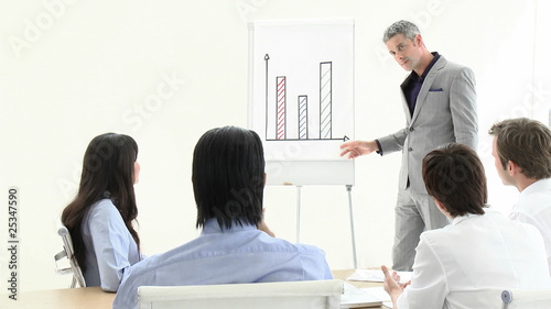 handsome manager explaining graphs during presentation