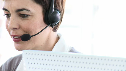 caucasian woman working in a call center