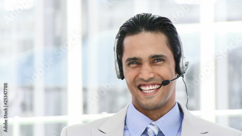 cheerful businessman with headset on