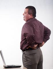 Attractive thirties hispanic businessman having backpain