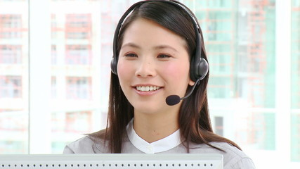 cheerful asian businesswoman with headset on