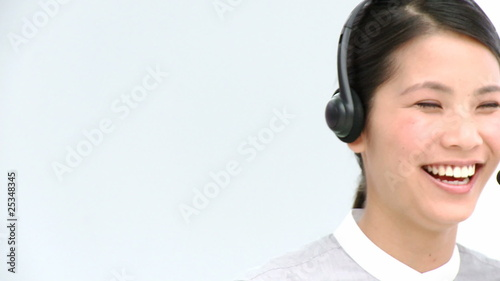 cheerful asian woman with headphone on