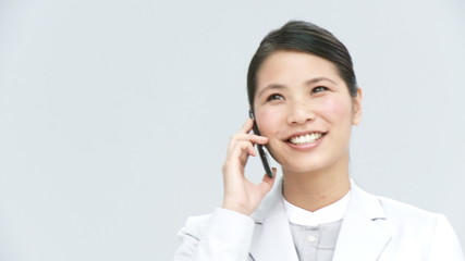 smiling asian businesswoman on the phone