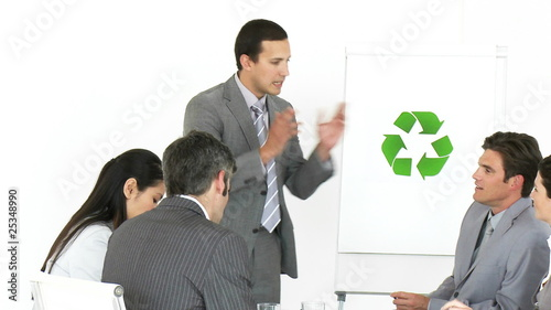 young business man explaining the concept of recycling
