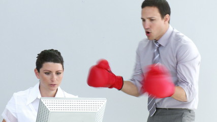 Competitive man encouraging his partner with boxing gloves