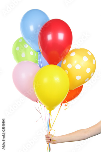 canvas print picture Hand holding balloons on white