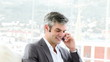 confident businessman on phone in his office