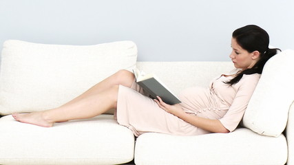 pregnant relaxing at home with a book