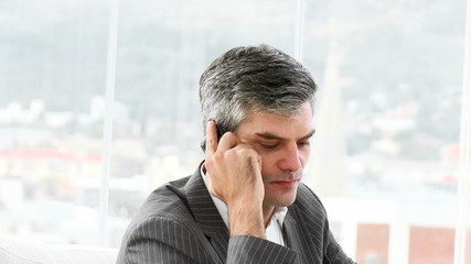 worried business man on phone