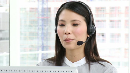 young asian woman with headset on