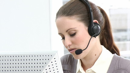 Brunette business woman working in a call center