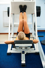 girl on leg machine
