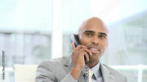 young business man talking on phone in his office