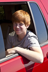 smilingboy sitting in a car