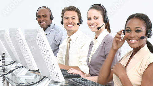joyful multi-ethnic team in a call-center