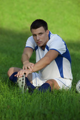 Young soccerplayer on the grass