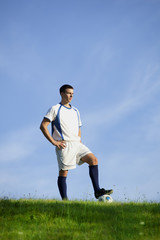 Handsome soccerplayer on grass