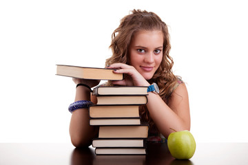 happy beautiful girl , with a stack of books, and a apple