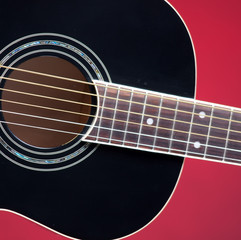 Black Acoustic Guitar On Red