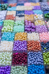 Beads in boxes on a Thai sunday market Chatuchak