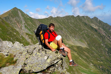 Tourist on Carpathian mountain trail