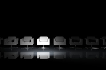 White armchairs on a black background