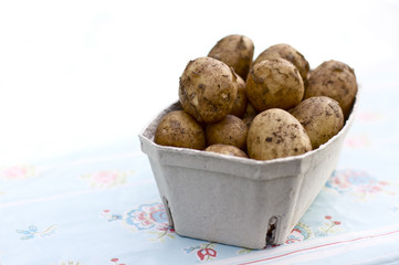Potatos in a box on a table