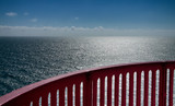 view over the ocean with handrail poster