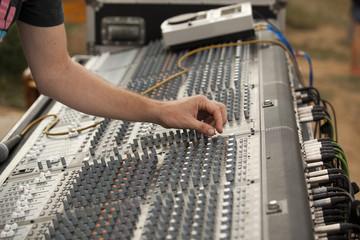 hand over music mixer