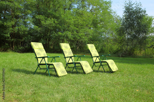 Three sunbeds on the grass
