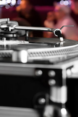 Turntable playing vinyl audio record