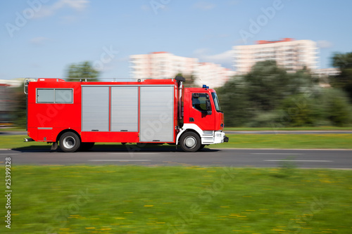 Panning image of fire truck in motion blur