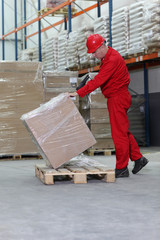 worker with bar code reader checking box on pallet