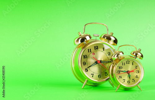 Leinwanddruck Bild Time concept - alarm clock against colorful background