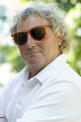 handsome middle age man portrait long hair sunglasses