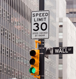 Fototapety Wall Street road sign in the corner of New York Stock Exchange