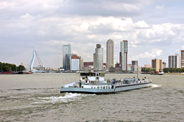 Cargo ship cruising in Rotterdam the Netherlands