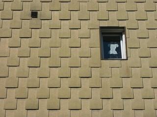 Oberfläche mit Struktur an einer dörflichen Fassade