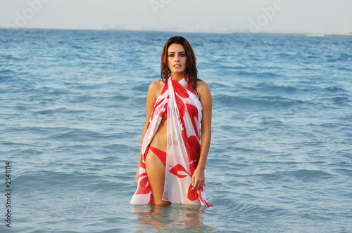 Young woman, standing in the sea