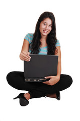 Girl sitting with laptop on floor.