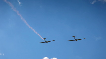 Two airplane on the sky circulate on blue cloudy sky
