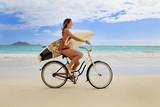 teenage girl with surfboard and bicycle on kailua beach - Fine Art prints