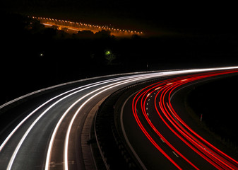 Highway with car lights trails at night
