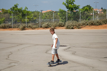 Young boy skateboarding.